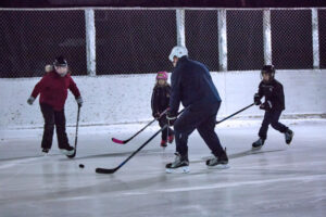 A family playing hockey
